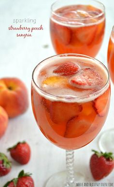 This fresh, fruity sangria will make any weekend a party! Perfectly fizzy and bubbly with plenty of juicy peaches and strawberries. @WholeHeavenly