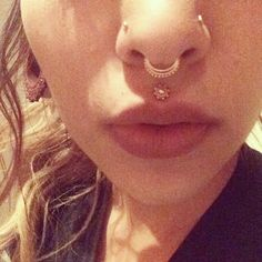 Lovely piercings, septum and medusa especially. Don't think I would personally go for a medusa, but it looks great on her.