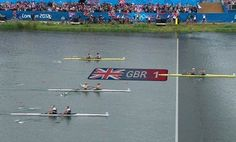 """319c - This picture reflects a sense of national pride, showing the exact moment Team GB won their first gold medal this year. This wide shot highlights how well ahead Team GB were from second-place. It wasn't a close race, suggesting Britain did well and other nations are playing catch-up. Using a screen grab from television pictures, the Union Jack flag installs a feeling of national identity and the phrase, """"GBR 1"""", suggests Team GB are the best in the world at this particular rowing event."""
