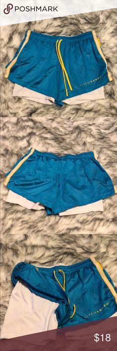 Women's Blue and Yellow Nike DRI-FIT Shorts Size M These shorts have the attached spandex underneath. They are blue with yellow and white accent colors. 84% Polyester and 16% Spandex. These shorts look great, no tears or snags. Nike Shorts