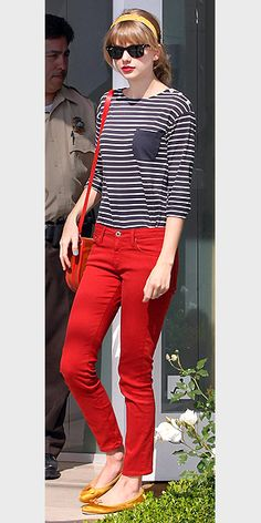TAYLOR SWIFT    Three cheers for the red, white and blue. The singer looks positively patriotic in a thin-striped Chinti and Parker top tucked into a pair of red skinnies.