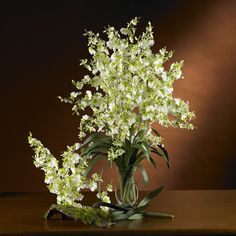 Dancing Lady Silk Orchid Flower (6 Stems)  - Are you looking for something personal to give that special loved one? Create your own Dancing Lady Silk Orchid arrangement using any one or all of these Nearly Natural silk flowers. Imagine how delighted the lucky recipient will be, especially when you tell them you made it! Color: Green, Height: 33 in, Number of Stems: 6. Number of Trunks: NA Number of Flowers: 6 Stems Number of Leaves: NA Pot Size: NA Color: Green Product Dimensions: 33 in H x…