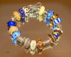 ~~Blues & Browns~~from a collector on Trollbeads Gallery Forum-so many great ideas!  Join us!