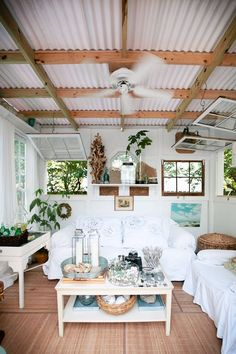 Beach cottage style  Metal roof and rustic windows; summer camp revisited.