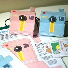 Printable paper cameras. So cute! put the website where you want guests to upload there snapshots of your wedding along with the username and pasword somewhere on it or you can place the info on a clear sticker label some where  on the camera. That way you will never miss a picture of your wedding day.