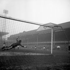 Swansea goalkeeper Noel Dwyer fails to make contact with the ball as Preston North End centre-forward Alex Dawson scores from the penalty spot during the 1964 FA Cup Semi Final at Villa Park