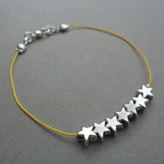7 tiny silver star charms on silk string - friendship bracelet (red or yellow)