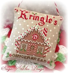 Kringles Gingerbread Cross Stitch Chart Model stitched on 32 ct Petit Point Raw Belfast Linen using DMC floss and Mill Hill Beads Stitch Count 47 x 61 Please note, this is for the pattern only. If you would like to custom order a finished item, please email me for details.