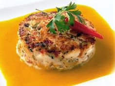 Crab Cake  1/4 cup mayonnaise 1/4 cup whipping cream 2 tablespoons tawny port wine 1 tablespoon capers 1 tablespoon diced red peppers 1/2 teaspoon dry mustard 1/2 teaspoon salt 1 scallion, with top, sliced 6 drops red pepper sauce 1 pound lump crab meat, cartilage removed 2 tablespoons dry bread crumbs 1 teaspoon butter or margarine, melted Snipped parsley Lemon wedges