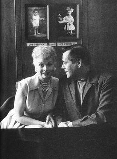 Lucille Ball and Desi Arnaz photographed in their Desilu Studios office, 1950s. The pictures hanging on the wall are photos of them as children.