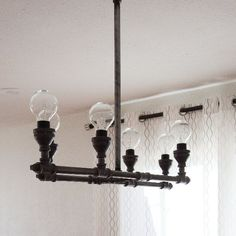 Create a DIY light fixture using steel pipe and fittings.