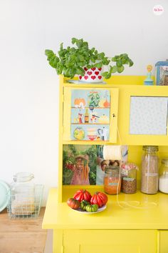 I just love this bright yellow in my kitchen, Syl loves