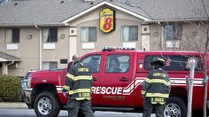 Hampton firefighters work at the scene of a morning fire inside the Super 8 motel on Thomas Street. The fire that damaged a room at the motel is believed to have started inside a plant sitting on a table. (Photo by Joe Fudge / Daily Press)