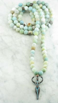 The Goddess Mala is made from 108 amazonite mala beads. Antiqued goddess guru in copper. This Mala is best for: Opening the heart chakra, harmony, compassion, truth and manifestation. Goddess Mala – 1