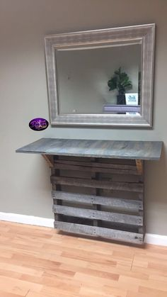Custom salon station! Pallet, wood shelf,  and mirror! Shelf painted with gray stain and coated with polyurethane!