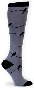Birds on Wire Gray Socks by Sock It to Me: Oh, the silhouette of birds on a wire. There's just something soothing about it! Just don't stand below these socks. You might get a treat on your head! 75% cotton, 20% polyester, 5% spandex. Made in Korea. Approximately fits women's shoe 5-10...