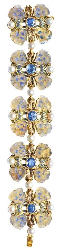 An Art Nouveau bracelet, by René Lalique, circa 1900. Gold, sapphires, moulded glass, enamel and pearls. #ArtNouveau #Lalique #bracelet