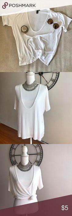 Forever 21 White Ribbed Plunging Neck Line Tee GENTLY WORN in Los Angeles <3 (Slight yellow stain in arm pit see photos) Size Small  Forever 21 White Ribbed plunging neck line tee. Great for a sexy look alone or with a cute bralette! Tie it up, tuck it in, make it casual or fancy! Forever 21 Tops Tees - Short Sleeve