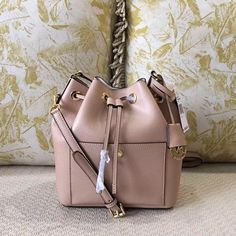 "Michael Kors medium Greenwich bucket bag#pink 29*24*14cm. With both strap and handle. Classic and fashion design, in beautiful light pink color. NWT and 100% authentic. price firm, no trade and no ""lowest?"" Plz  Michael Kors Bags Crossbody Bags"
