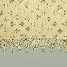 Small square cloth with entire surface divided into lozenges with each lozenge subdivided into four small lozenges with crosses of reticella. Border of pointed triangular tabs of bobbin lace.