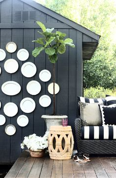 hunted-interior-patio.jpg (650×999)... not the plates though, but I love the black shed and everything else