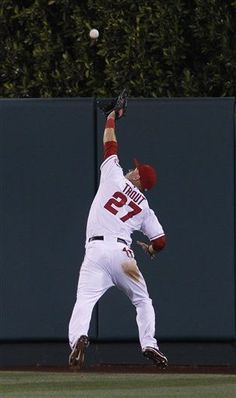 Game #53 6/1/12: Los Angeles Angels center fielder Mike Trout (27) makes a running catch off Texas Rangers' Elvis Andrus in the seventh inning of a baseball game in Anaheim, Calif., on Friday June 1, 2012. (AP Photo/Christine Cotter)