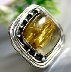 https://www.etsy.com/listing/223543760/rutilated-quartz-ring-statement-ring?ref=shop_home_active_12