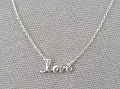 """Mini Love Sterling Silver Necklace. Perfect for Valentine's Day, engagements, mother's day, and more, this darling mini """"LOVE"""" necklace will show them you mean what you say. Sterling silver mini love charm measuring .6""""x.25"""" hangs from a 16"""" sterling silver chain with a 2"""" extension and lobster clasp closure. All of our jewelry is comes boxed and ribboned, ready for gift giving (or gift keeping)!"""