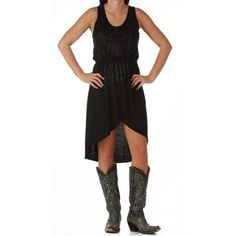 This cute dress from Rock & Roll Cowgirl is a racer back. It has an elastic waist to help it to stay in place. The front of the dress has black rhinestuds. The bottom of the dress is a high - low, higher in the front and lower in the back. The edges are a raw hem. The racer on the back it a hematite beaded coil. Wear this dress with your cowboy boots, or your heals and we guarantee you will be looking your best.