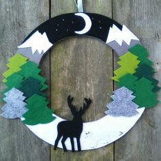 Updates from FeltWitch on Etsy First Winter wreath of the season made, featuring snow capped Mountains, thick pine trees, a stag and Arctic fox Christmas Makes, Christmas Art, Christmas Mesh Wreaths, Winter Wreaths, Winter Trees, Spring Wreaths, Summer Wreath, Felt Wreath, Yarn Wreaths