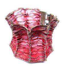 A Pawel Kaczynski bracelet made of silver and dyed steel mesh.