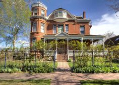 A unique opportunity to own one of Denver's historic landmarks. Currently an operating bed & breakfast and wedding/events venue, this beautiful Queen Anne Victorian is truly one of a kind. Built in 1890 and lovingly restored in the early 1990s, the Lumber Baron Inn exudes original character and charm. As you approach the house, you cant miss the striking wraparound front porch which leads into the home through a grand set of oak double doors. The first floor features a front and back parlor…