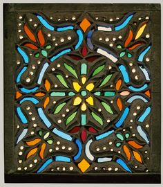 """""""Window:"""" This stain glass window is an example of """"asymmetrical balance."""" The colors used are repeated in a pattern shown in all for corners and make your eyes flow all around the window."""