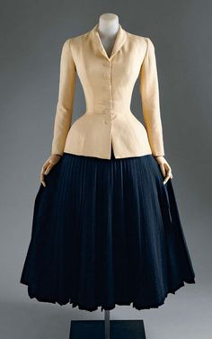 Silk jacket, wool skirt. This Bar Suit was the most famous look in Dior's influential 1947 collection.