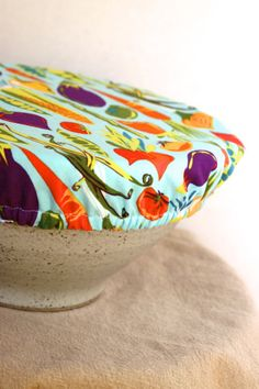 Make your own bowl cover tutorial. An easy beginner project. Great for keeping nibbling fingers out of the bowl and could replace plastic wrap if the fabric is water resistant like oilcloth.