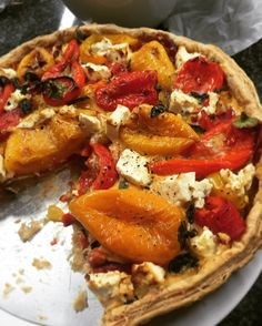 Lots of lovely roasted peppers hanging out together in a tart shell.. #testkitchen