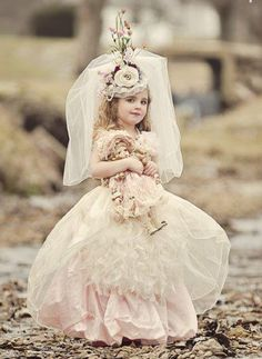 Little vintage girl with her doll...