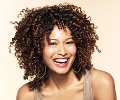woman smiling, brown curly hair