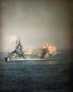 (Color): USS Idaho Fires the guns of Turret Three at nearly point-blank range, during the bombardment of Okinawa, 1 April Photographed from USS West Virginia Official U. Navy Photograph, now in the collections of the National Archives. Okinawa, Naval History, Military History, Idaho, Uss Iowa, Uss Texas, Us Battleships, Go Navy, Us Navy Ships