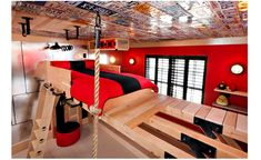 A rad climbing bedroom-Kidtropolis style–This boldly red, brilliantly rad bedroom features a climbing rope, ladder and wall!