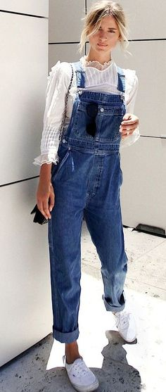 denim overall. white top. sneakers.