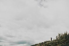 bride and groom on mountaintop - love all the pics from this wedding