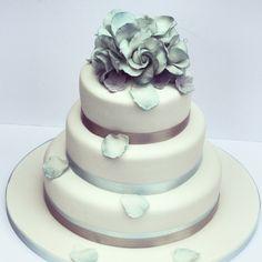 Duck egg blue wedding cake with cascading sugar petals  www.janerosecakes.com