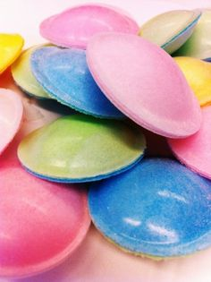 Flying Saucers - they really did taste like a communion wafer with little white sugar ball-bearings inside.