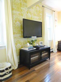 TV mounted on wall.