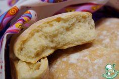 """Шотландские хлебцы """"Бапсы"""" -       Молоко (теплое) — 175 мл     Вода (теплая) — 175 мл     Дрожжи (сырых или 2 ч. л. сухих) — 20 г     Мука — 3,5 стак.     Соль — 1 ч. л.     Сахар — 1 ч. л."""