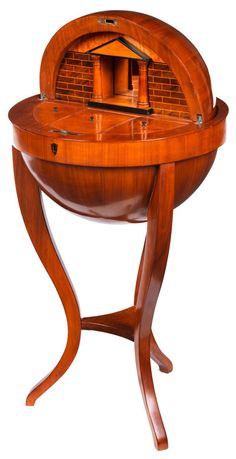Elegant Biedermeier table globe South Germany, 19th century.  Hardwood structure, including oak. Cherry veneer, partially ebonized and walnut. With key. In good overall condition. Restored.