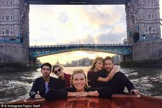 More romance! Taylor and Calvin cosy up while enjoying a private boat tour of London's River Thames