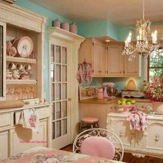 Look at this kitchen! It's tea parties and gossip, tiny cakes and ... a little much, but very lovely.