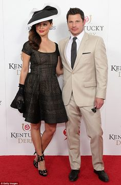 Best accessory: The former MTV host posed with her handsome husband Nick Lachey, who looke...
